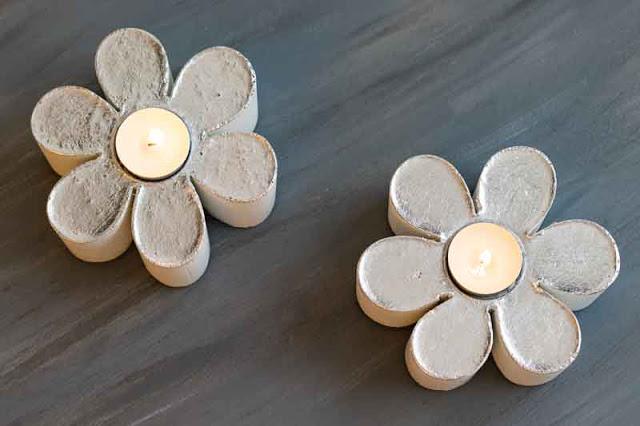 portavelas de cemento en forma de flor terminados